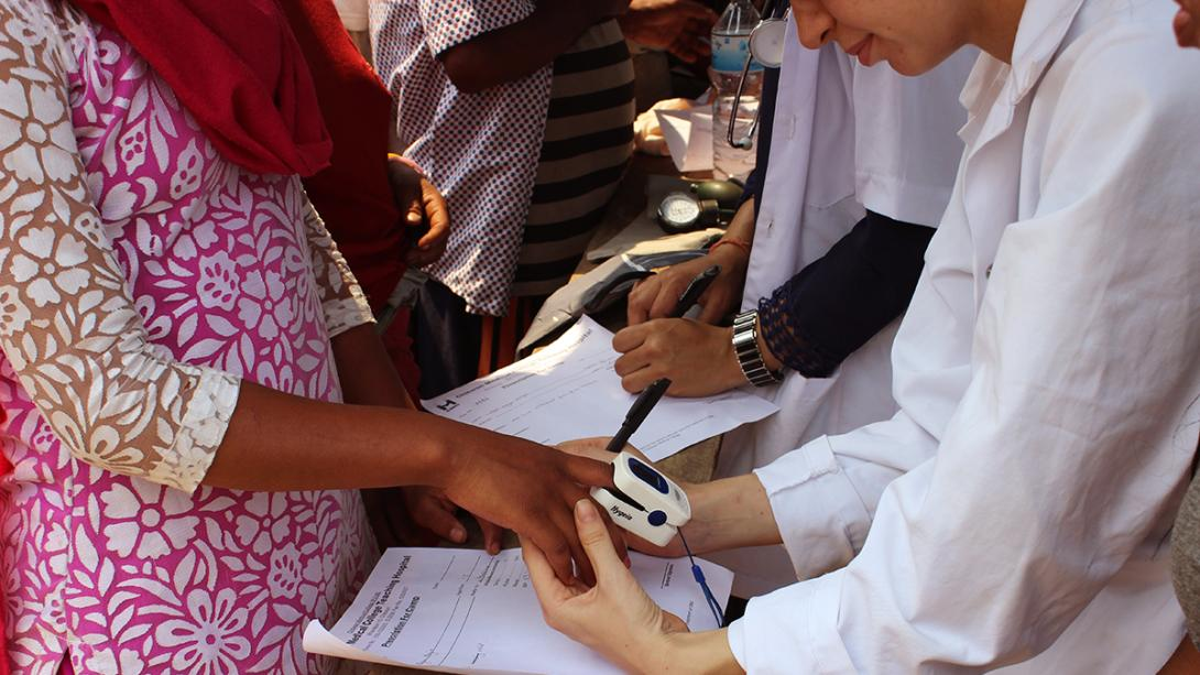 Medical interns abroad check people's blood pressure during an outreach in Nepal